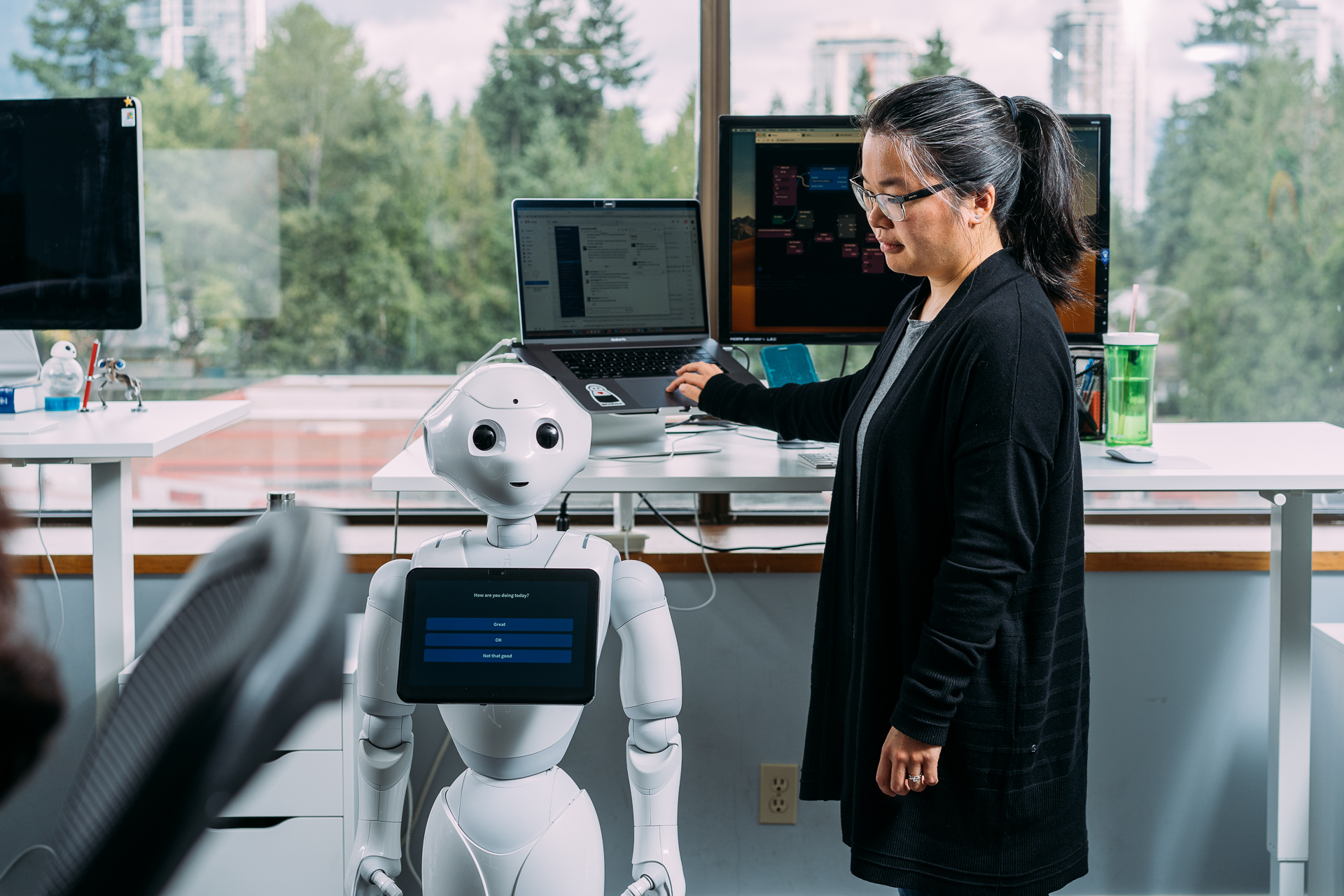 Image of woman looking at robot